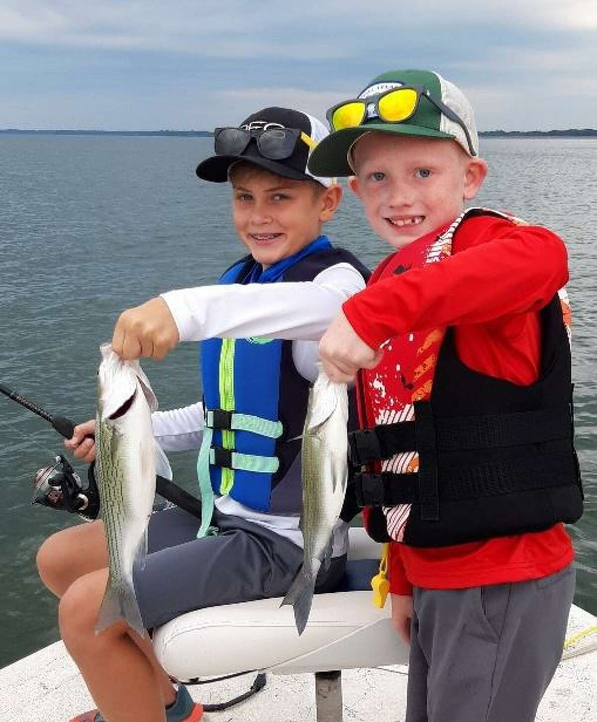 Hybrid stripers and white bass are eating machines that are almost always willing to cooperate during the summer months. Both are great options for youngsters to get their feet wet in fishing.