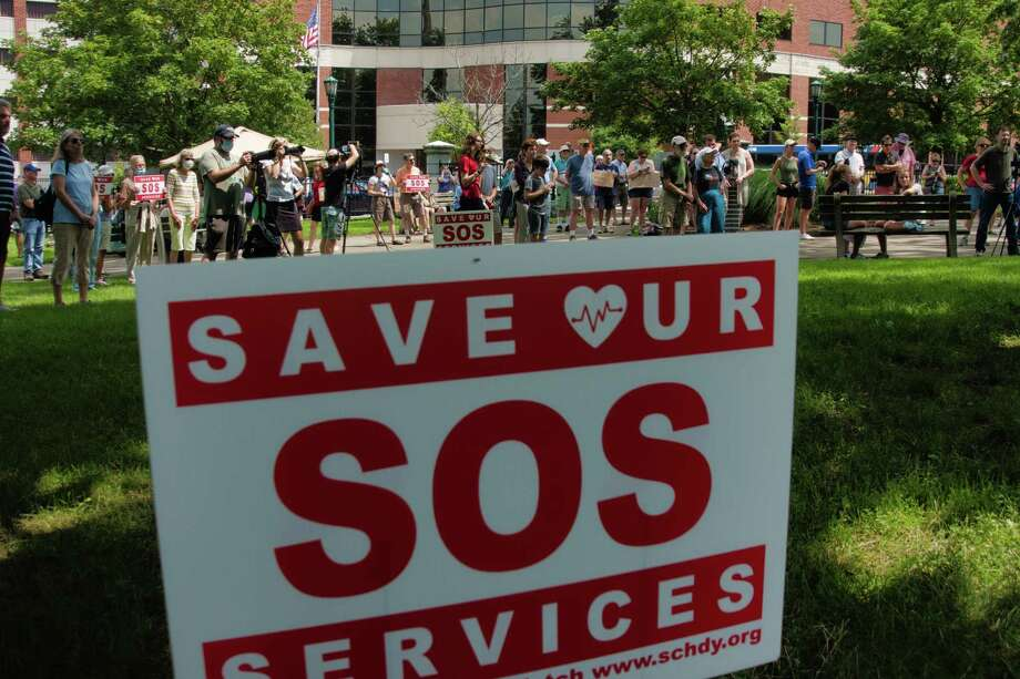 People gather for the SOS: Save Our Services Rally at Veteran's Park on Sunday, July 25, 2021, in Schenectady, N.Y. Those attending the rally say they have concerns about the loss of services that may result from the proposed merger of Ellis Medicine and Trinity Health, which is a Catholic heathcare system.     (Paul Buckowski/Times Union) Photo: Paul Buckowski, Albany Times Union / (Paul Buckowski/Times Union)