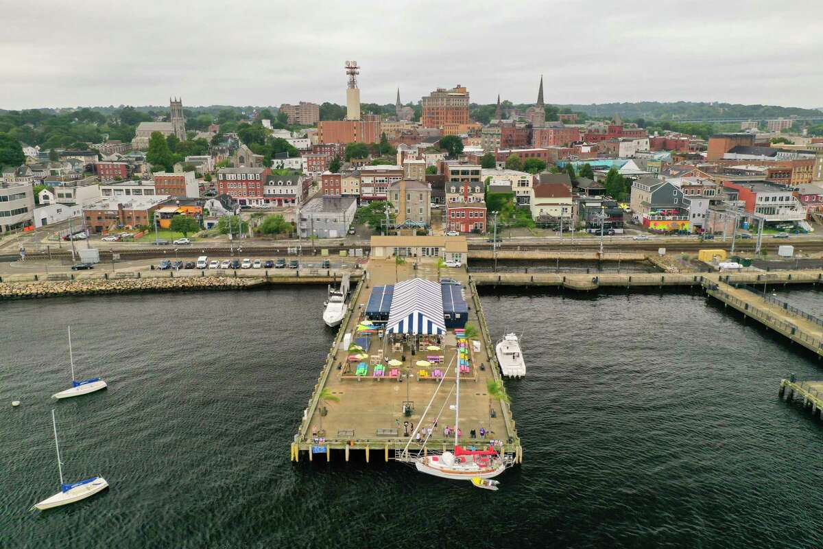A drone view of the New London waterfront near the site of an offshore wind project at the State Pier.