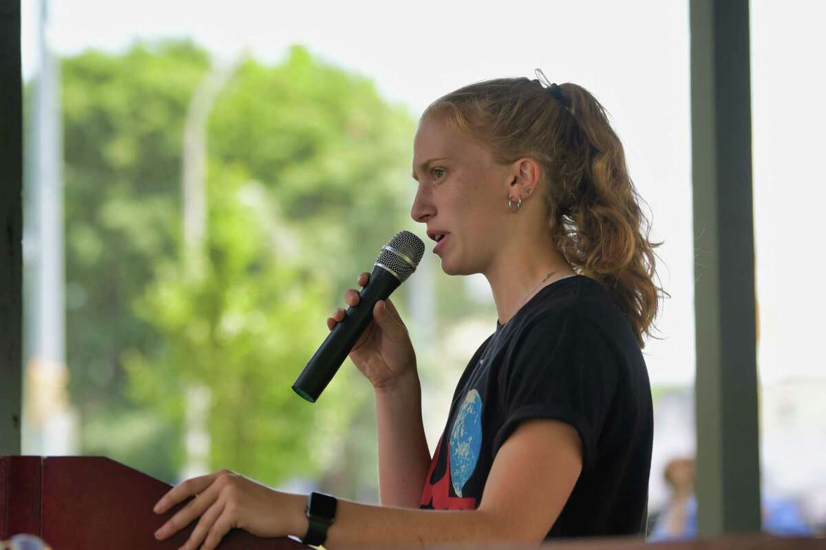 Emma Anderson, a 2021 Niskayuna high School graduate and a volunteer at Bellevue Woman's Center, speaks at the SOS: Save Our Services Rally at Veteran's Park on Sunday, July 25, 2021, in Schenectady, N.Y. Those attending the rally say they have concerns about the loss of services that may result from the proposed merger of Ellis Medicine and Trinity Health, which is a Catholic heathcare system. (Paul Buckowski/Times Union)