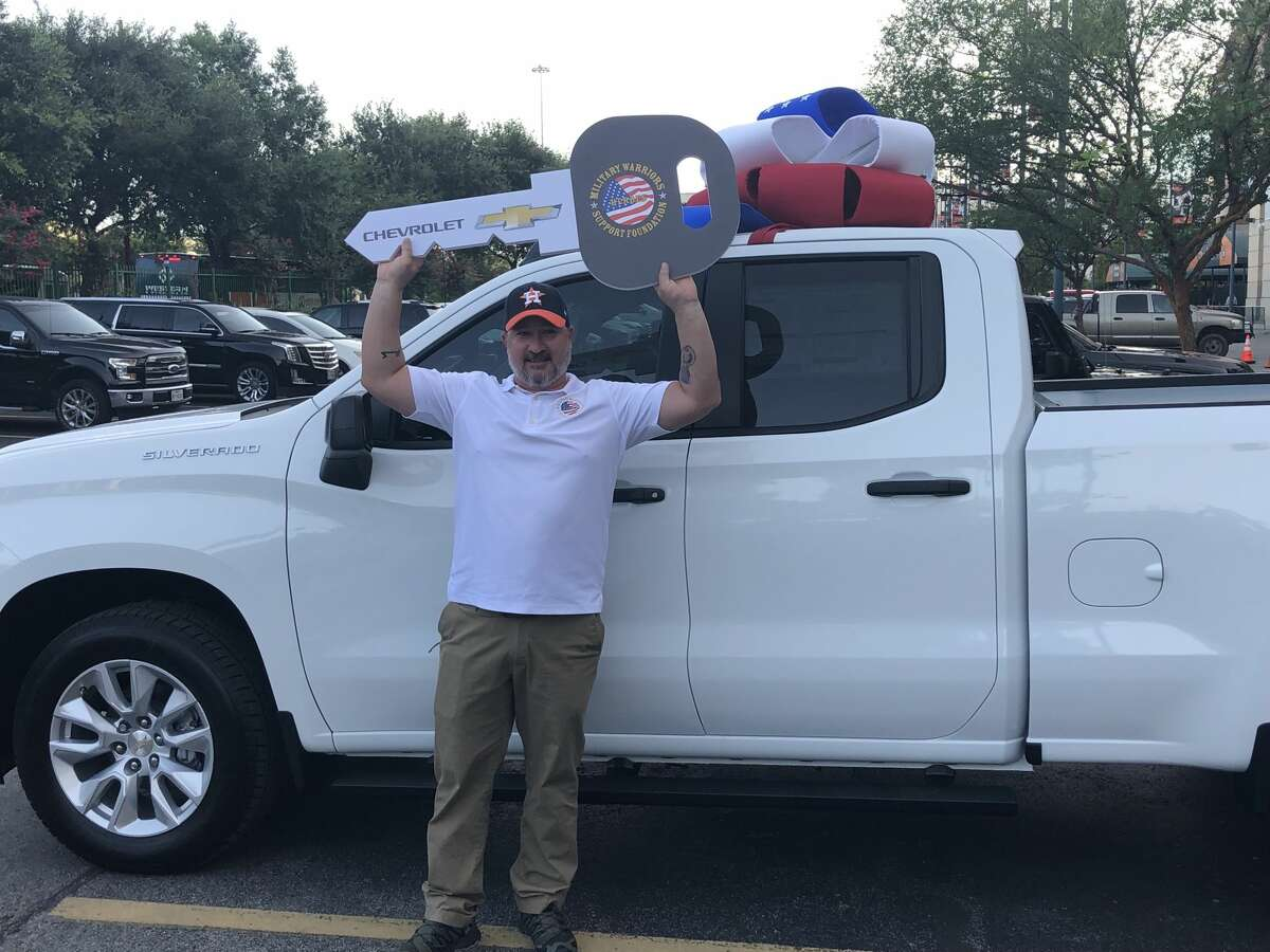 Patrick Davis, who earned two Purple Hearts, was surprised with this Chevrolet Silverado 1500 Double Cab before Saturday's Astros game.