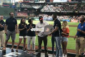 Patrick Davis, who earned two Purple Hearts, is surprised with a Chevrolet Silverado 1500 Double Cab before Saturday's Astros game.