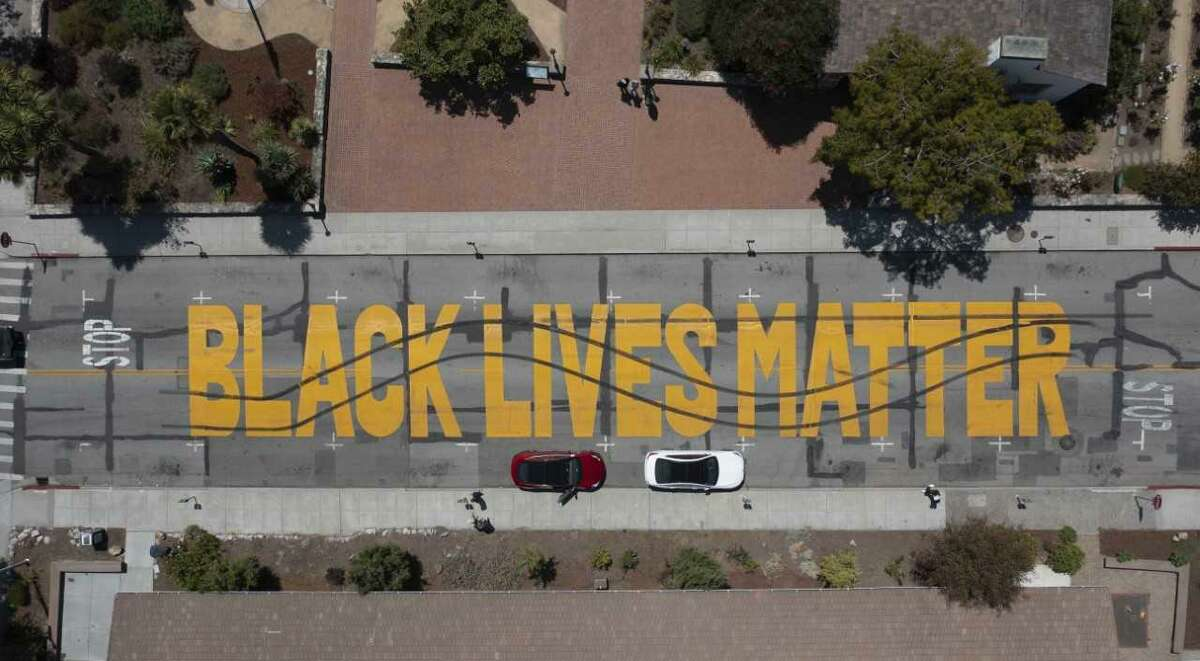 Police in Santa Cruz said they have arrested two suspects in the in the alleged defacing of a Black Lives Matter mural on Center Street with tread marks.
