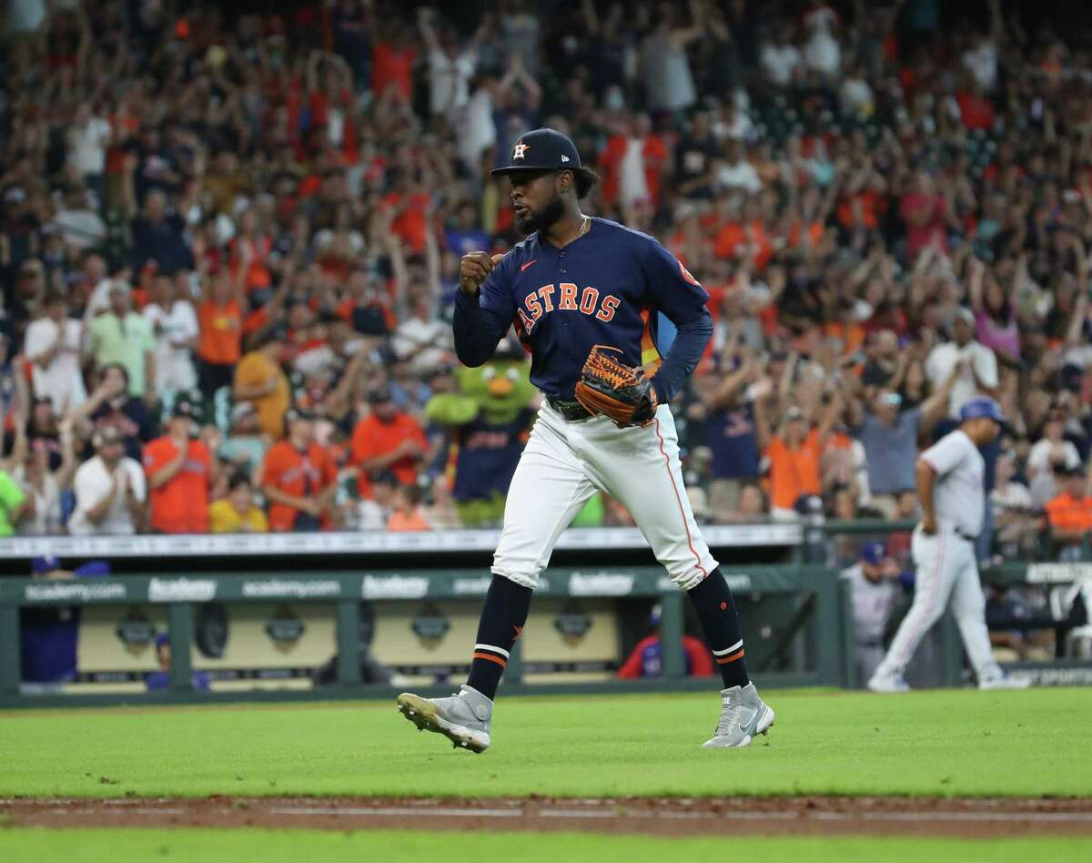 Astros reliever Cristian Javier celebrates after getting out of a bases-loaded, no-out jam during the seventh inning of Sunday's 3-1 win over the Texas Rangers at Minute Maid Park.