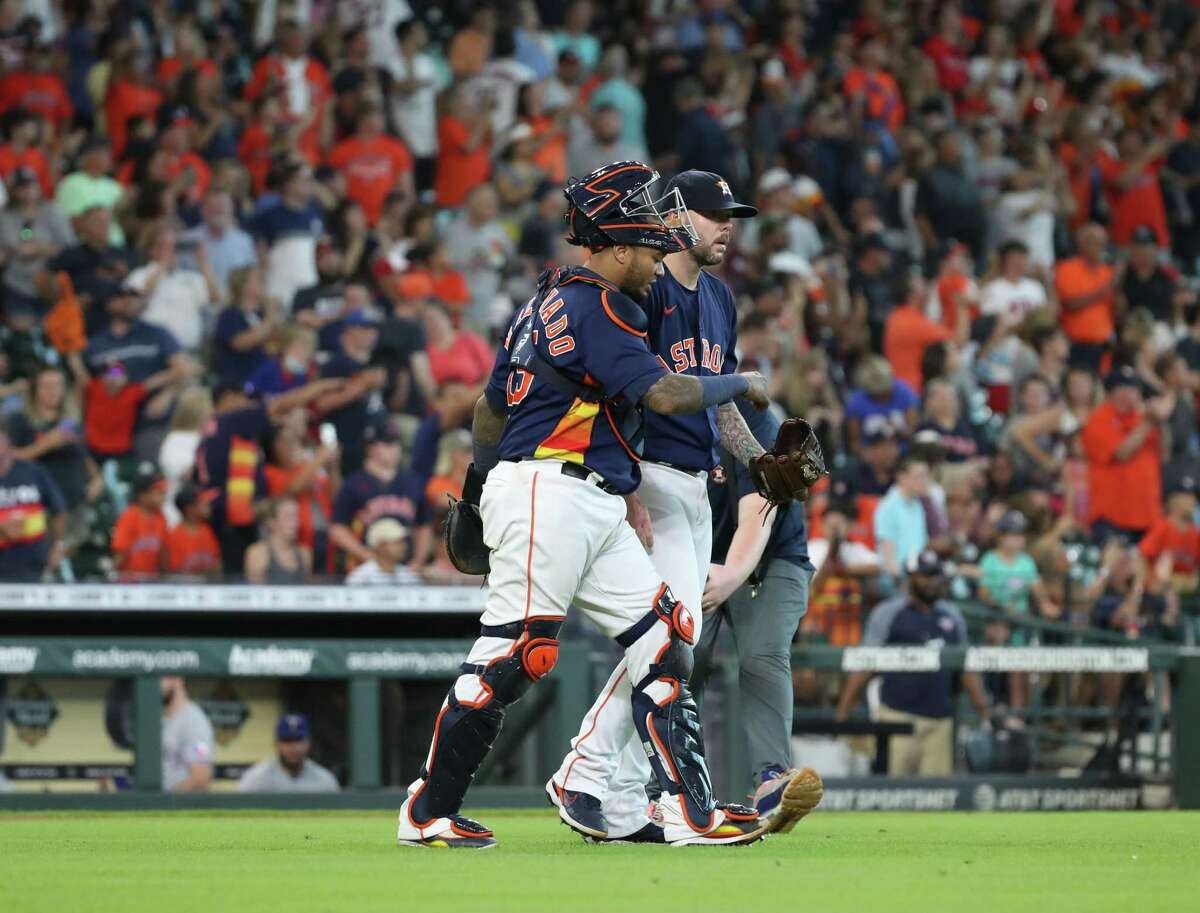 Houston Astros catcher Martin Maldonado (15) and Houston Astros relief pitcher Ryan Pressly (55) talk after the Houston Astros beat the Texas Rangers on Sunday, July 25, 2021, at Minute Maid Park in Houston.