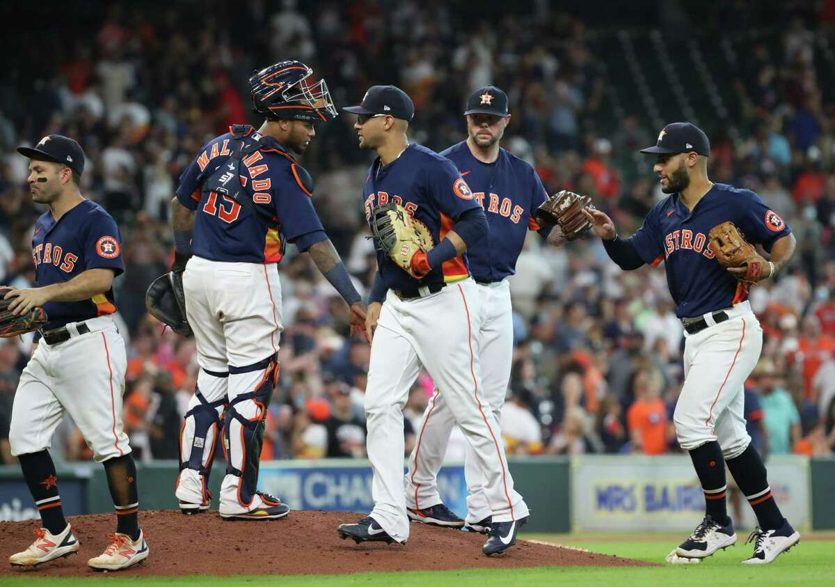 Houston Astros celebrate after beating the Texas Rangers on Sunday, July 25, 2021, at Minute Maid Park in Houston.