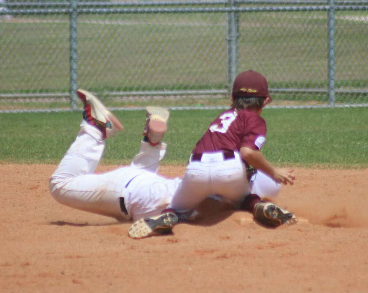 Deer Park second baseman Aysen Miller (3) tries to take a Southwest runner off the basepaths with this tag attempt during Saturday's South Zone semifinal game.