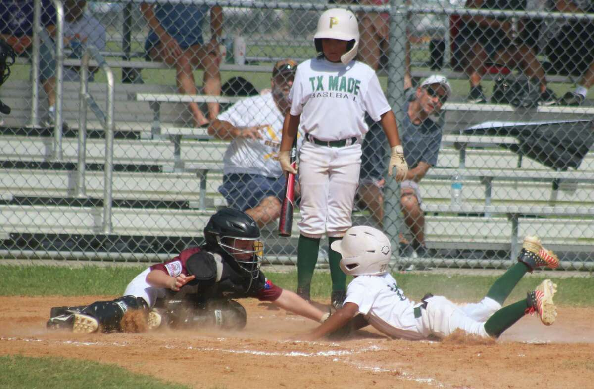 Southwest scores one of its third-inning runs during Saturday's semifinal contest at Ruth Minchen Field.