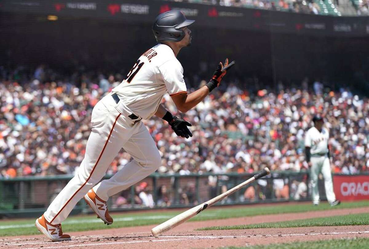 The Giants' LaMonte Wade Jr. watches his home run against the Pirates in the third. Wade hit two out and has 12 total.