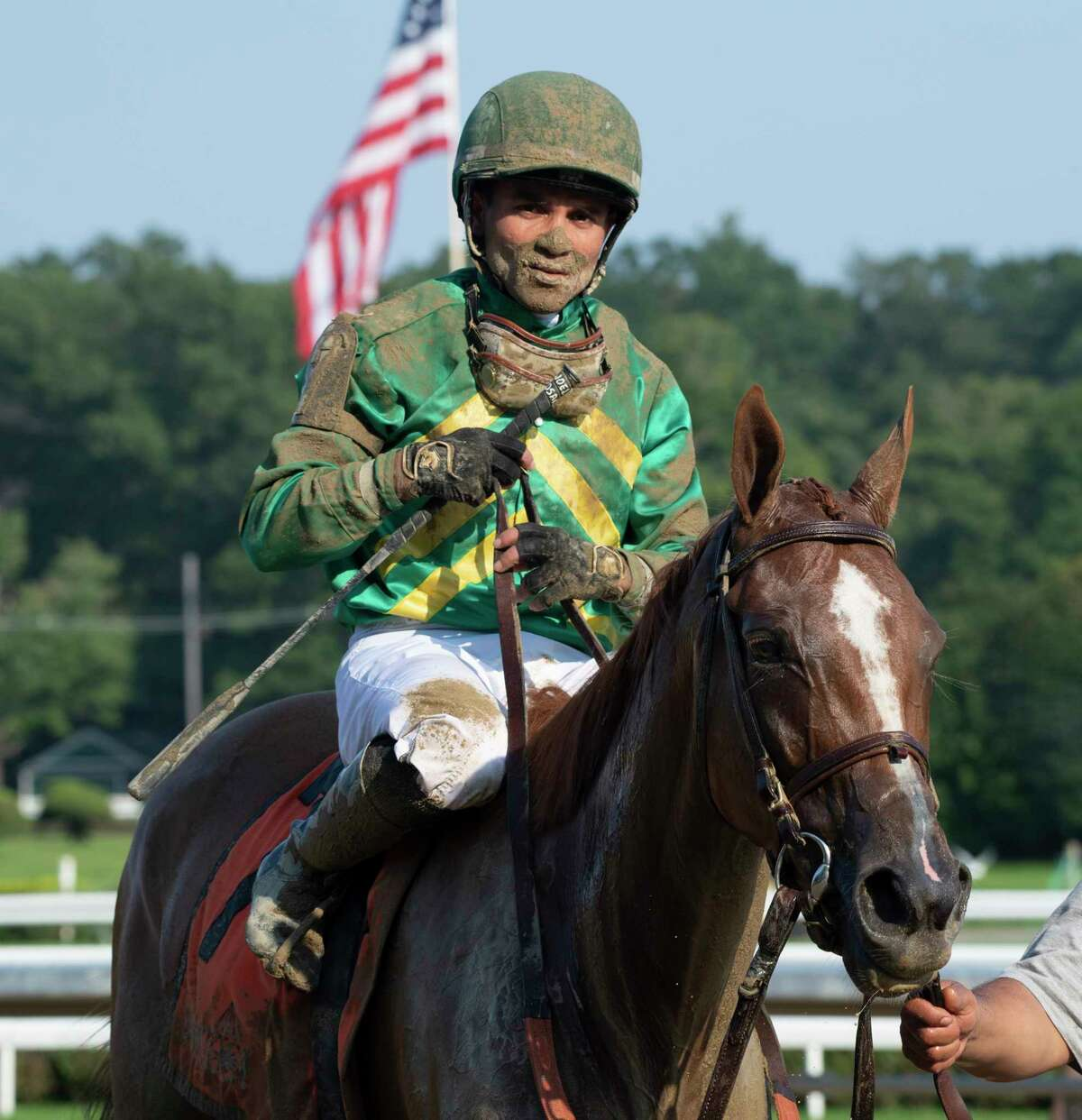 Royal Flag with jockey Joel Rosario who was covered with track mud heads to the winner?•s circle after winning the 45th running of The Shuvee at The Saratoga Race Course Sunday July 25, 2021 in Saratoga Springs, N.Y. Photo by Skip Dickstein