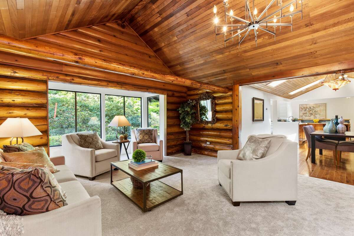 Inside the main home are elements ofclassic log cabin design.