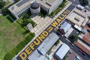 Giant, yellow letters, seen Aug. 18, 2020, painted on Victoria Street in front of the federal courthouse in Laredo.