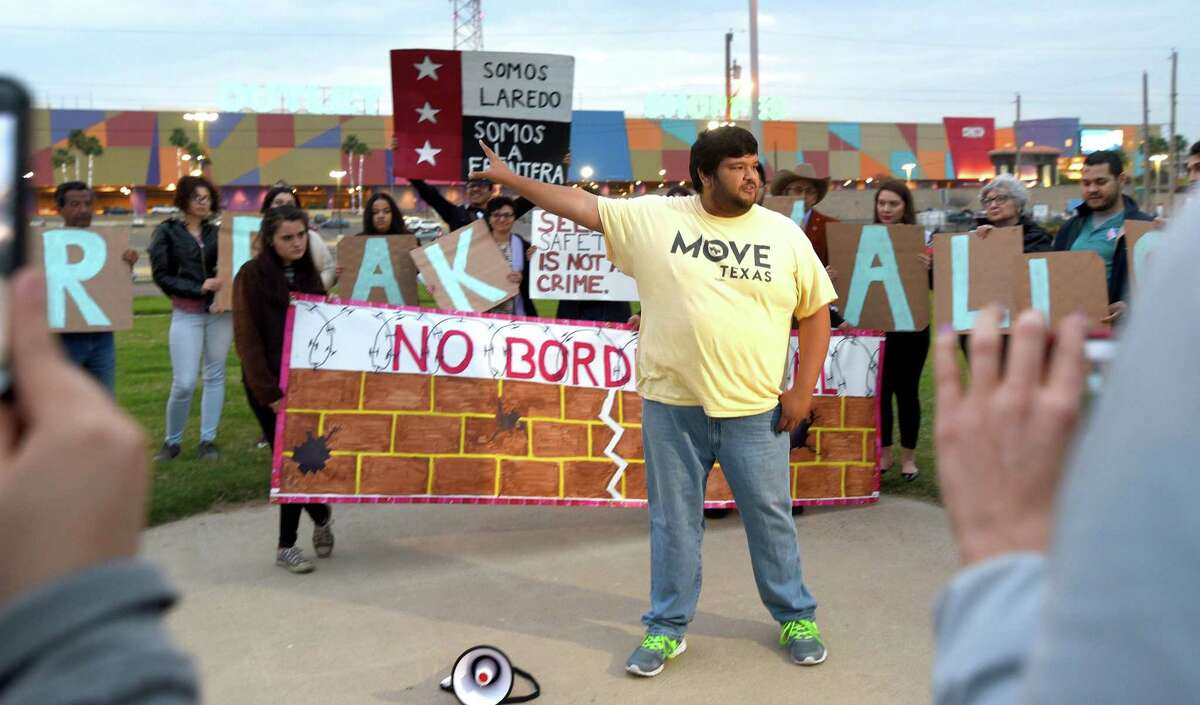 Move Texas representative Jesus Ochoa joins the Laredo Immigrant Alliance and community members as they gather at Tres Laredos Park on Monday, Feb. 11, 2019, to voices their opposition to the border wall proposed by President Donald Trump.
