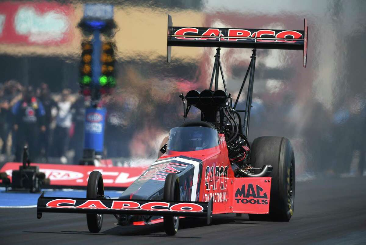 In this photo provided by the NHRA, Steve Torrence continued his dominance in the Top Fuel ranks as he picked up the win at Sonoma Raceway when we went 3.757 seconds at 327.98 mph to defeat Leah Pruett in the final round, Sunday, July 25, 2021 in Sonoma, Calif. He is now the only NHRA driver with the chance to sweep the 2021 Western Swing as the tour continues to Pomona next week. (Marc Gewertz/NHRA via AP)