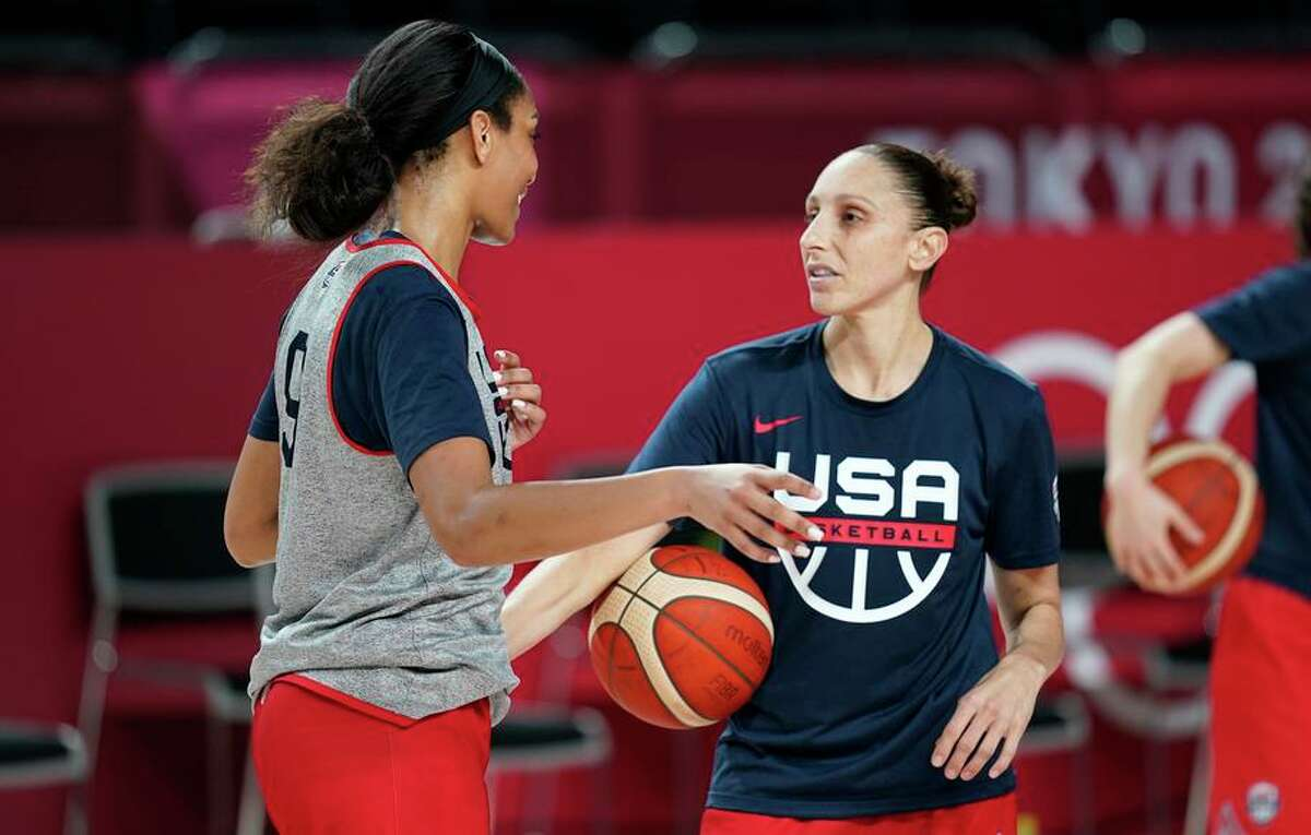 Diana Taurasi (right) talks with A'Ja Wilson during a practice in Saitama, Japan, for the U.S. women's basketball team.