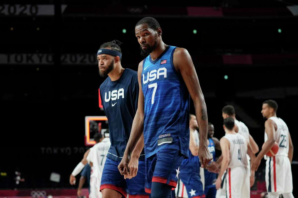 United States' Javale Mc Gee, left, and forward Kevin Durant (7) walk off the court after their loss to France in a men's basketball preliminary round game at the 2020 Summer Olympics, Sunday, July 25, 2021, in Saitama, Japan. (AP Photo/Eric Gay)