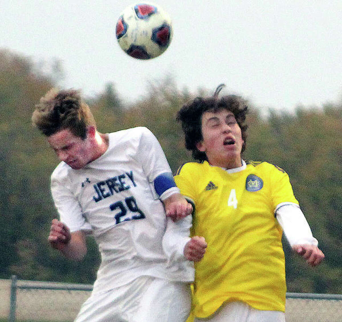 Andrew Kribs of Jersey, left, goes up with CM's Grant Hailey for a headball in a 2019 game.