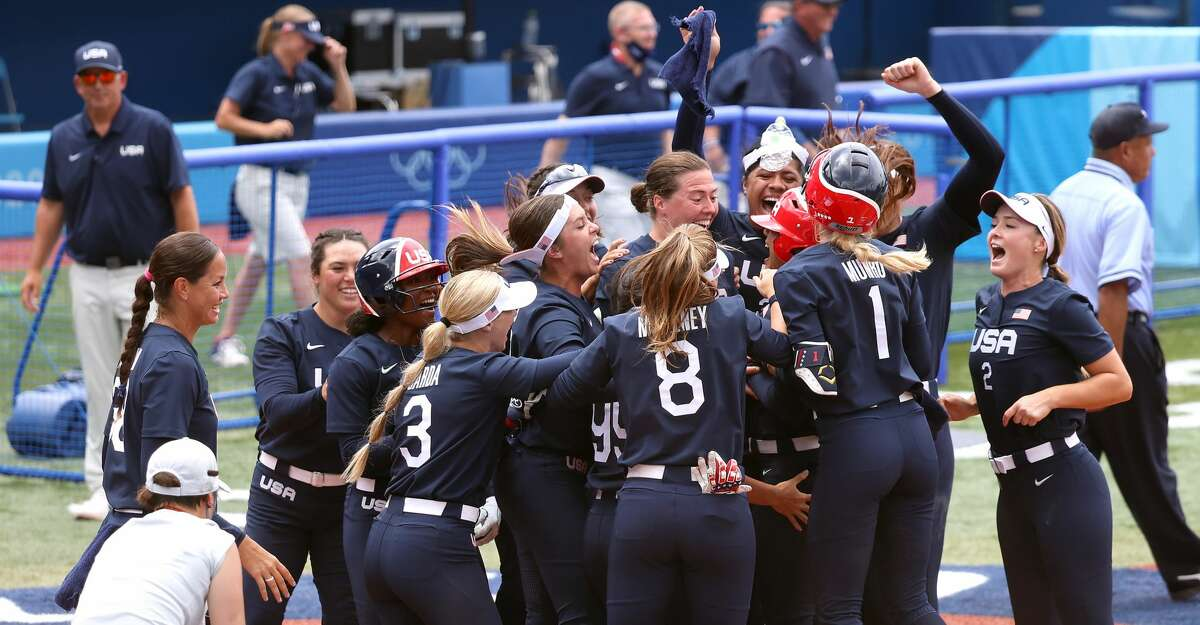 Team United States players celebrate with teammate Kelsey Stewart #7 after she hit a walk-off home run to win the game 2-1 against Team Japan during softball opening round on day three of the Tokyo 2020 Olympic Games at Yokohama Baseball Stadium on July 26, 2021 in Yokohama, Kanagawa, Japan. (Photo by Yuichi Masuda/Getty Images)