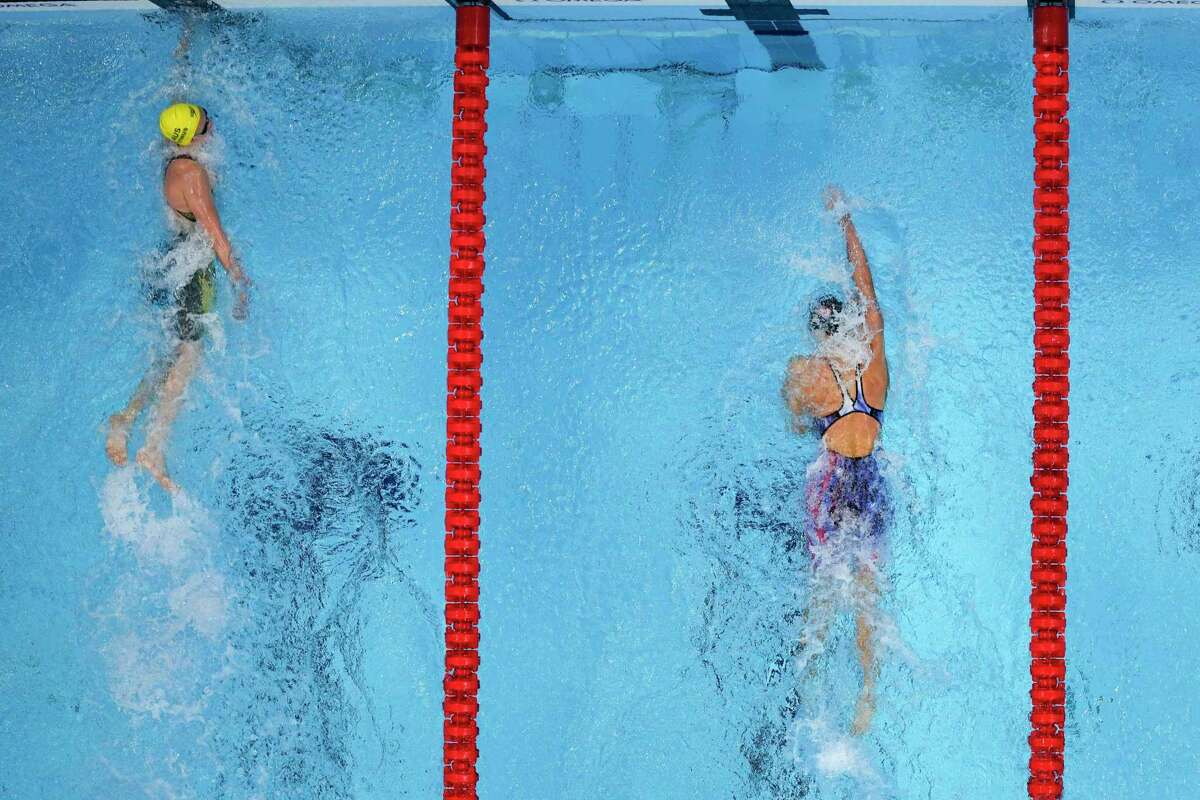 Ariarne Titmus, left, of Australia wins the final of the women's 400-meters freestyle ahead of Katie Ledecky, of the United States, at the 2020 Summer Olympics, Monday, July 26, 2021, in Tokyo, Japan. (AP Photo/David J. Phillip)