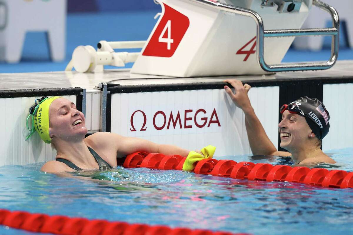 TOKYO, JAPAN - JULY 26: Ariarne Titmus of Team Australia and Katie Ledecky of Team United States react after competing in the Women's 400m Freestyle Final on day three of the Tokyo 2020 Olympic Games at Tokyo Aquatics Centre on July 26, 2021 in Tokyo, Japan. (Photo by Clive Rose/Getty Images)