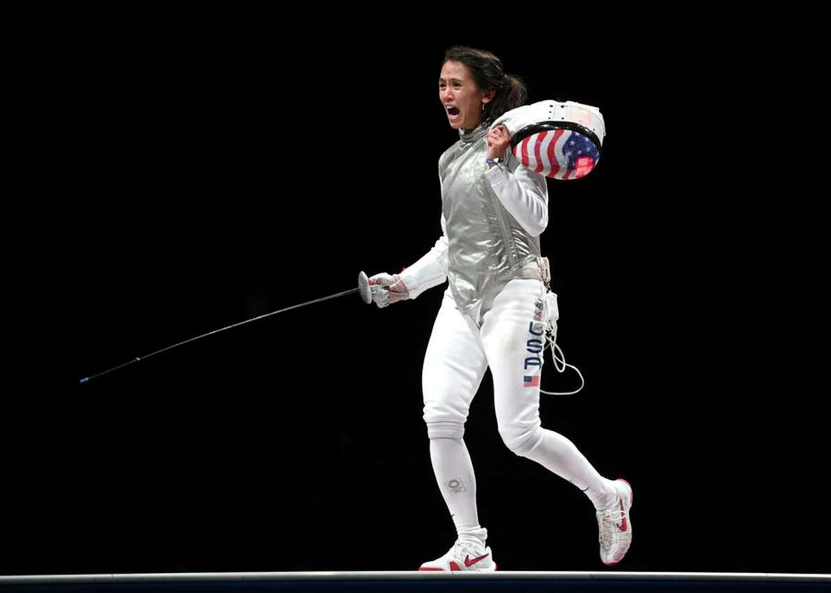 American fencer Lee Kiefer celebrates winning the women's foil individual fencing gold medal bout in Chiba, Japan.