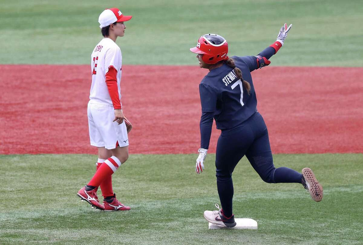 Kelsey Stewart of the U.S. rounds second after her walk-off home run to beat Japan 2-1 to finish group play in softball.