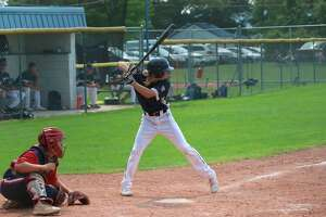 Alex Schmitt bats for the Saints during a home game on July 18. (Record Patriot file photo)