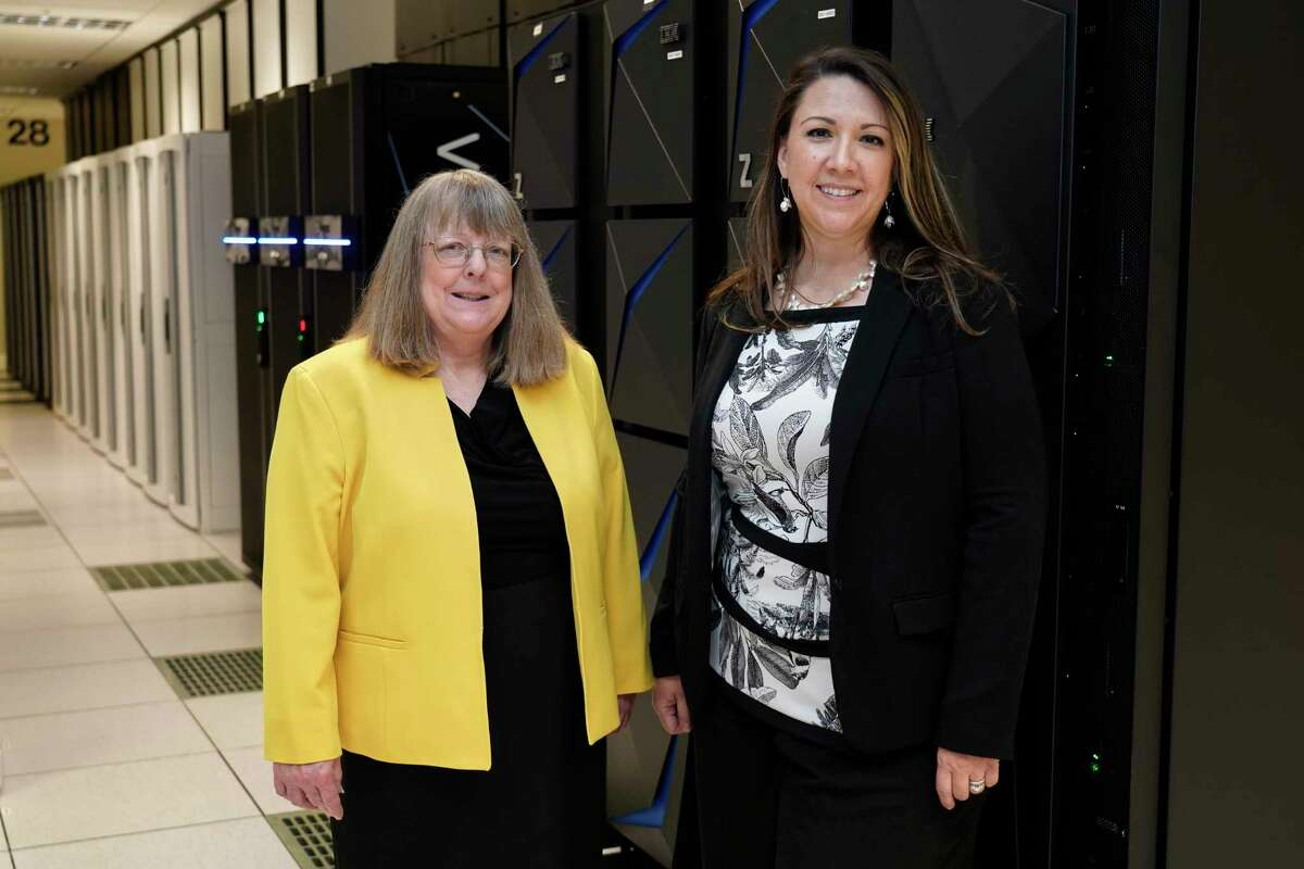 In this July 19, 2021, photo Amanda Crawford, right, and Nancy Rainosek, left, pose for a photo inside the state's Information Resources Data Center in Austin, Texas.