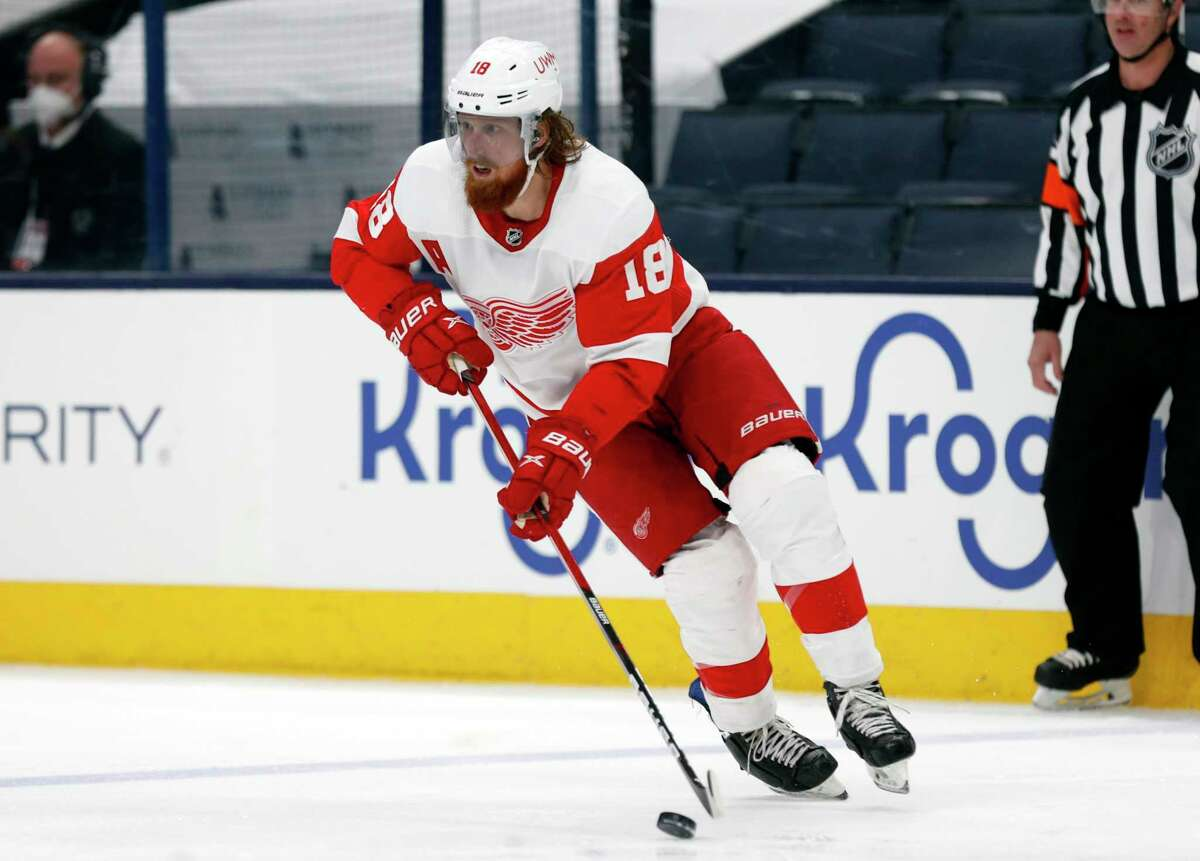 FILE - In this May 8, 2021, file photo, Detroit Red Wings defenseman Marc Staal controls the puck during an NHL hockey game against the Columbus Blue Jackets in Columbus, Ohio. Staal is staying put in Detroit, while the Vancouver Canucks placed Jake Virtanen on waivers on Sunday, July 25, 2021, for the purpose of buying out the final year of the under-performing forward's contract. (AP Photo/Paul Vernon, File)