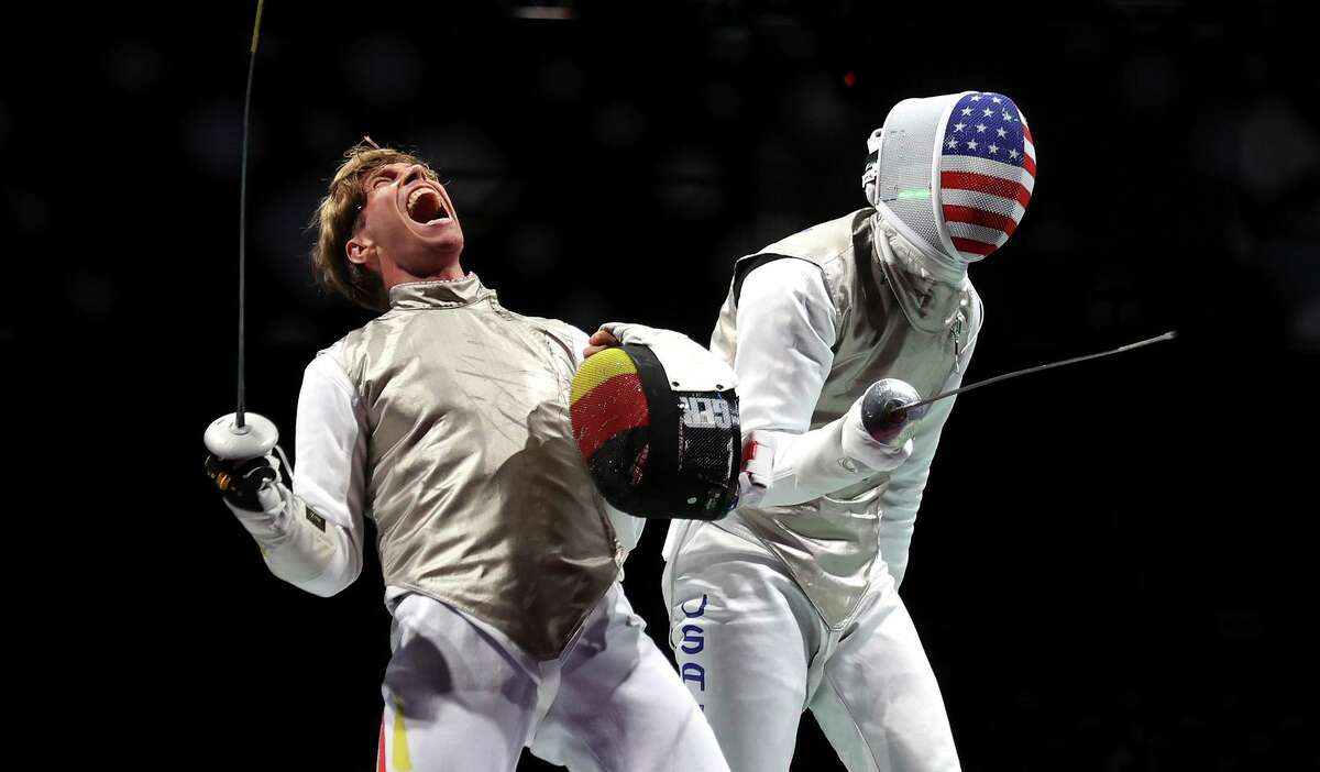 CHIBA, JAPAN - JULY 26: Peter Joppich of Team Germany, left, celebrates after defeating Alexander Massialas of Team United States in Men's Foil Individual second round on day three of the Tokyo 2020 Olympic Games at Makuhari Messe on July 26, 2021 in Chiba, Japan. (Photo by Elsa/Getty Images)