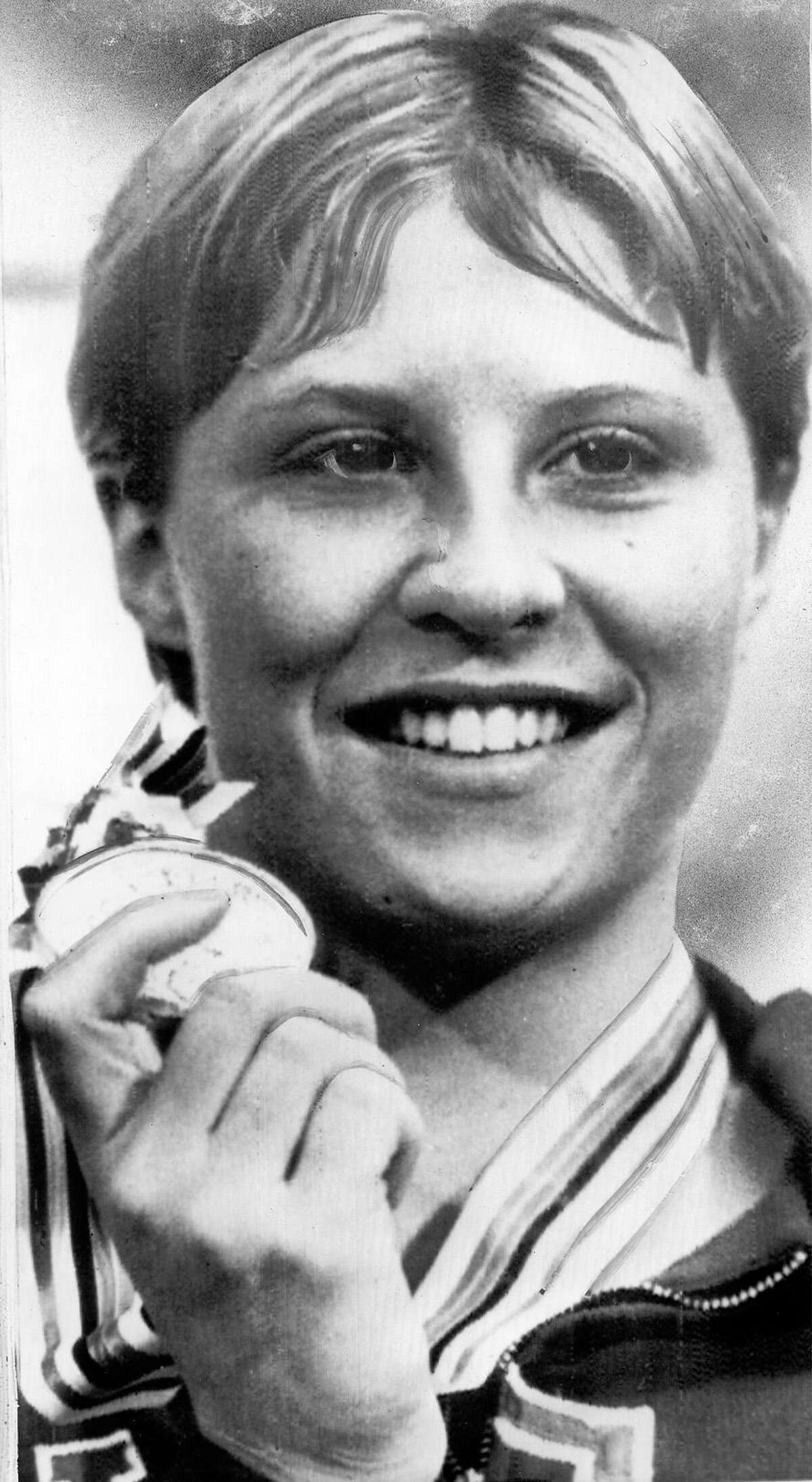 Donna de Varona, 17, shows the gold medal she won by taking the women's 400-meter individual medley swim event at the Olympics in Tokyo in 1964.