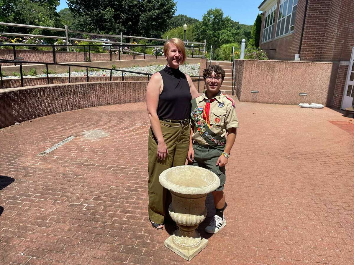 Standing in the middle the soon to be renovated senior center patio, alongside a planter that will soon be filled with flowers, are (l-r) Courtney Burks, director of the senior center and Ethan Franco, Life Scout from Boy Scouts of America Troop #38.