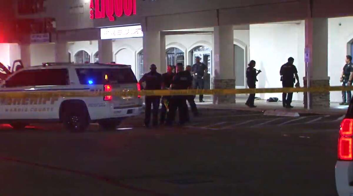 Police investigate the shooting of a woman on July 25, 2021, in a parking lot in the 14000 block of FM 1960.