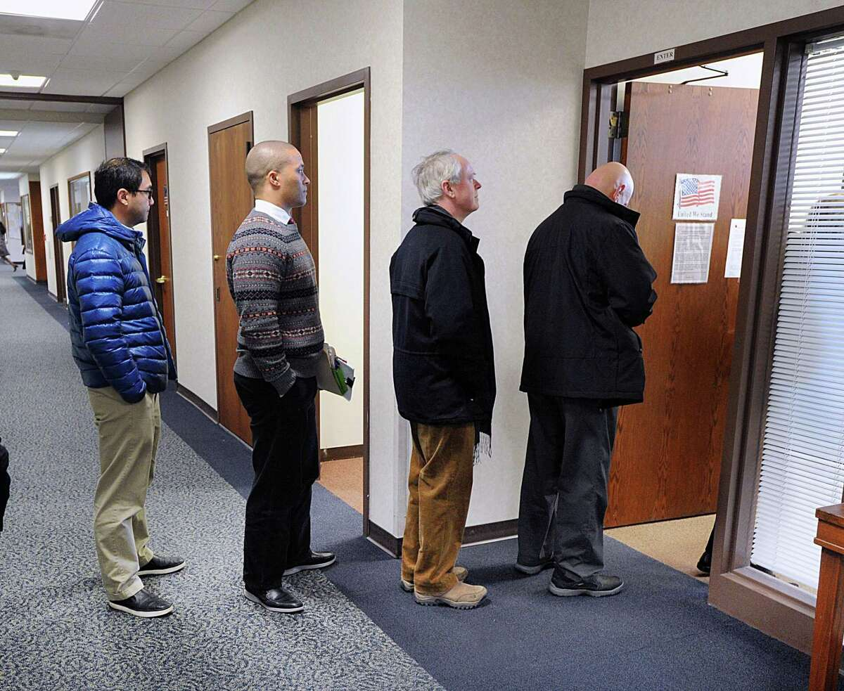 Need to pay your taxes? Get in line, like these Greenwich residents. who paid their taxes at Greenwich Town Hall in Greenwich, Conn., Thursday, Dec. 28, 2017.