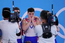 The Russian Olympic Committee's Nikita Nagornyy celebrates after winning the gold medal in the artistic men's team final at the 2020 Summer Olympics, Monday, July 26, 2021, in Tokyo.