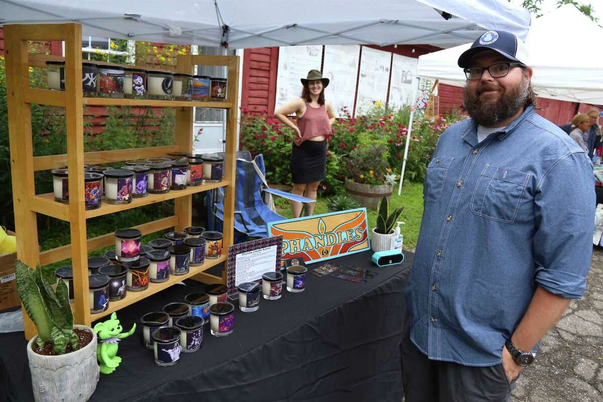 Chad Anderson of Bridgeport, along with his new bride, Sarah, show off their new Phandles business at the Eco Market at Wakeman Town Farm on Sunday, July 25, 2021, in Westport, Conn.