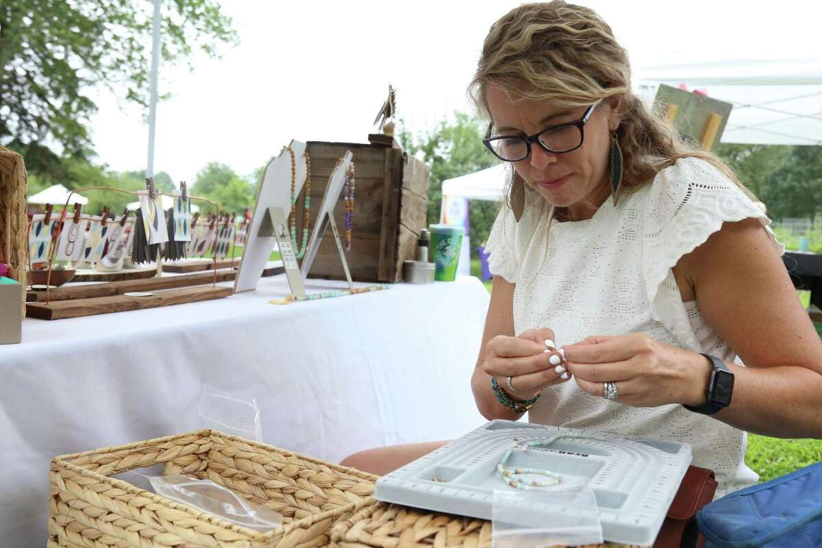 Brooke Lalumiere of Fairfield's Pink Moon by Brooke works on her art at the Eco Market at Wakeman Town Farm on Sunday, July 25, 2021, in Westport, Conn.