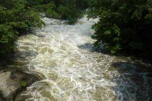 The Housatonic River flows just north of Bulls Bridge in South Kent, Conn, on Thursday, July 22, 2021.
