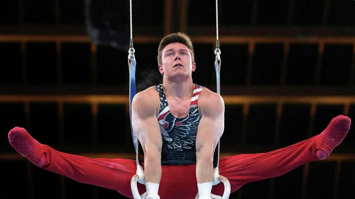Brody Malone, of the United States, performs on the rings during the artistic gymnastic men's team final at the 2020 Summer Olympics, Monday, July 26, 2021, in Tokyo. (AP Photo/Gregory Bull)
