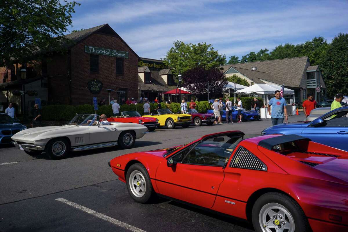 People gather at Cars and Coffee at the Great Falls, Va., city center on July 10, 2021.