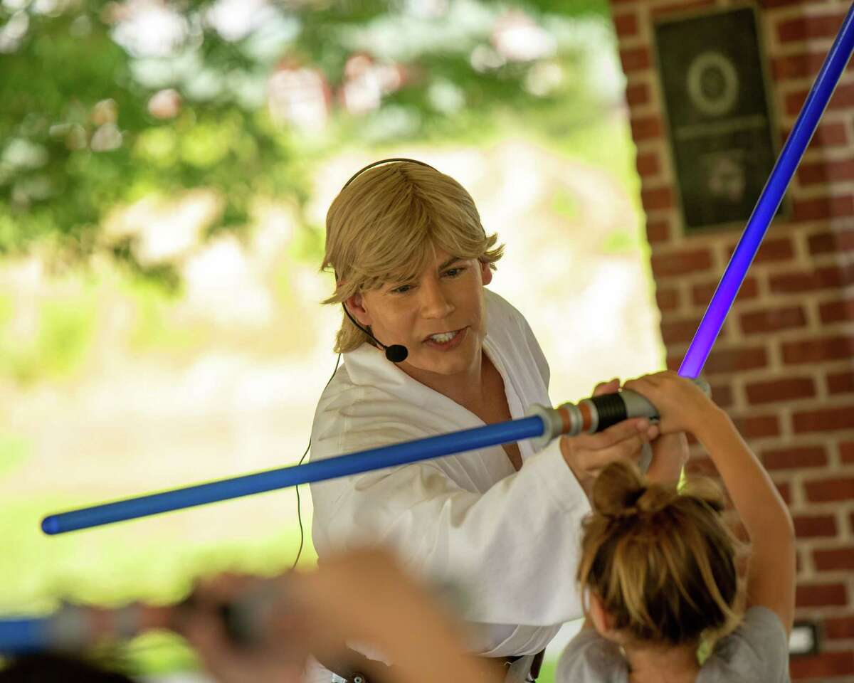 A actor portraying Luke Skywalker trains young Jedi at the Shelton Rotary as part of Jedi training sponsored by the Shelton Library System on Saturday, July 24, 2021.