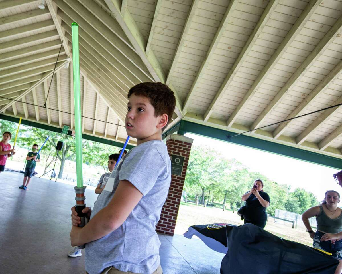 Sebastian Oliveria, 9, stands at the ready with his lightsaber during Jedi training held by the Shelton Library System on Saturday, July 24, 2021.