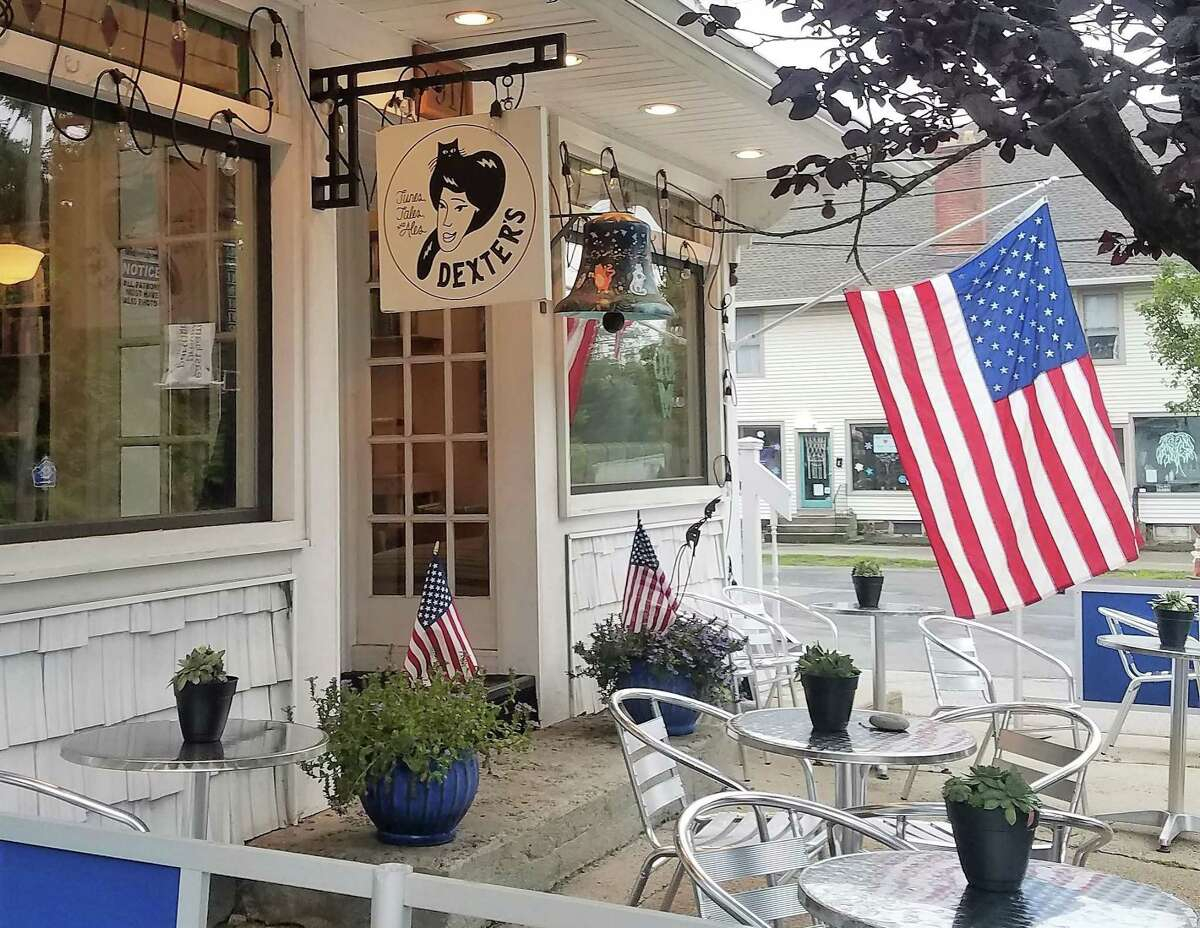 Dexter's Tunes, Tales & Ales in East Hampton, which is under new ownership, celebrated its grand opening July 8. Town Manager David Cox, owner Martha Wick, owner's daughter Olivia Wick, employees Leslie Wilson and Kate Neitzel, and Middlesex Chamber of Commerce Vice President Johanna Bond (not shown) attended the event.
