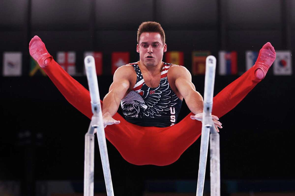TOKYO, JAPAN - JULY 26: Samuel Mikulak of Team United States competes on parallel bars during the Men's Team Final on day three of the Tokyo 2020 Olympic Games at Ariake Gymnastics Centre on July 26, 2021 in Tokyo, Japan. (Photo by Jamie Squire/Getty Images)