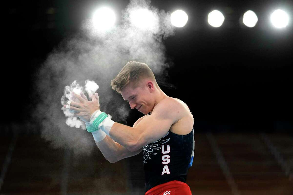 Shane Wiskus, of the United States, reacts after finishing his performance on the rings during the artistic gymnastic men's team final at the 2020 Summer Olympics, Monday, July 26, 2021, in Tokyo. (AP Photo/Gregory Bull)