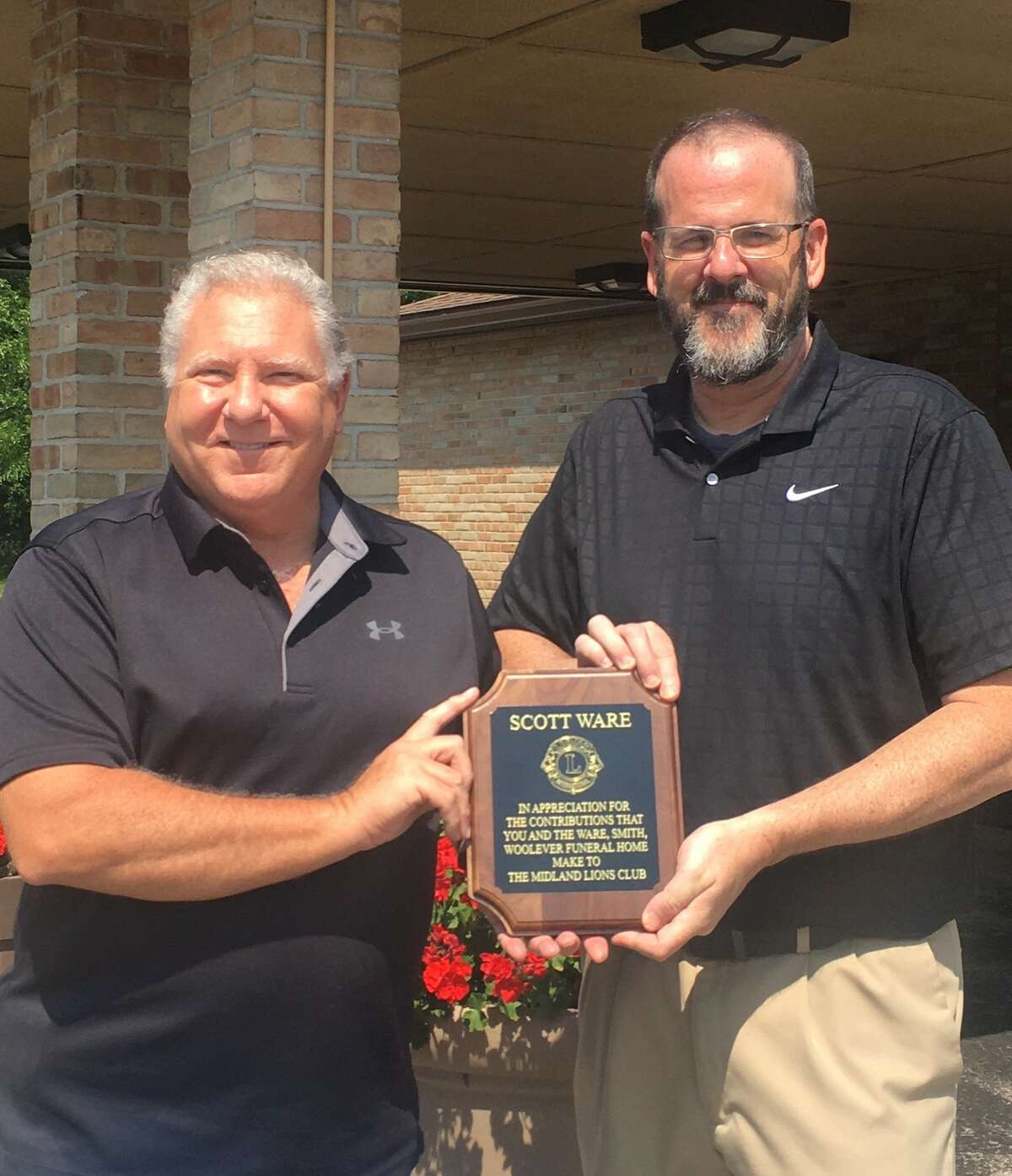 Midland Lions Scott Ware, left, and Rick Ratell were among those honored by the Midland Lions Club at its Awards Night on June 15 at the Midland Country Club.