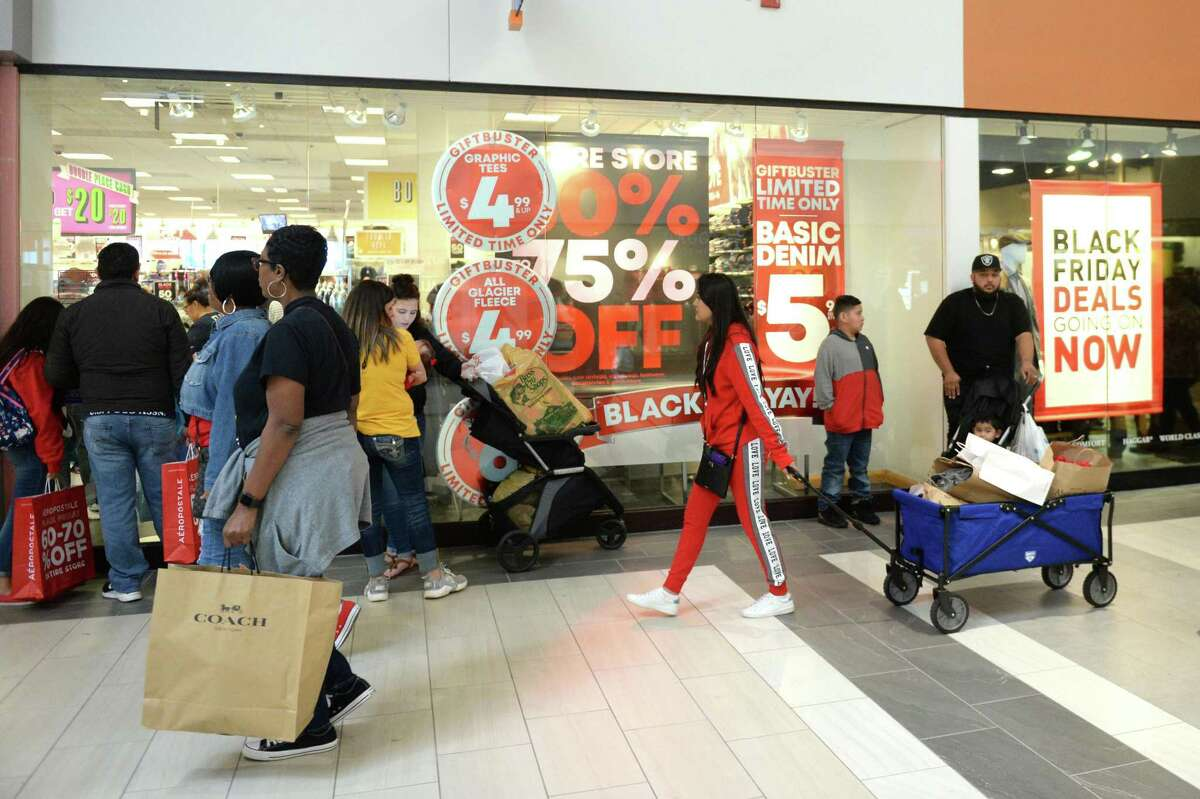 Shoppers are spending more and that's putting money in the city's coffers through sales tax receipts. Shown in this file photo, shoppers look for bargains at the Katy Mills Mall on Black Friday, Nov. 23, 2018.