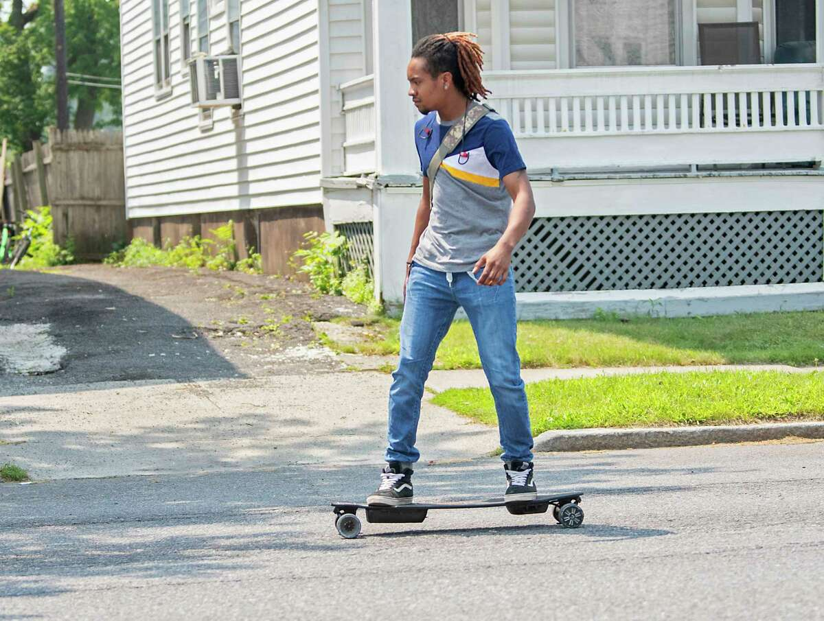 A man rides a longboard east on Washington Ave. on Monday, July 26, 2021 in Albany, N.Y. (Lori Van Buren/Times Union)