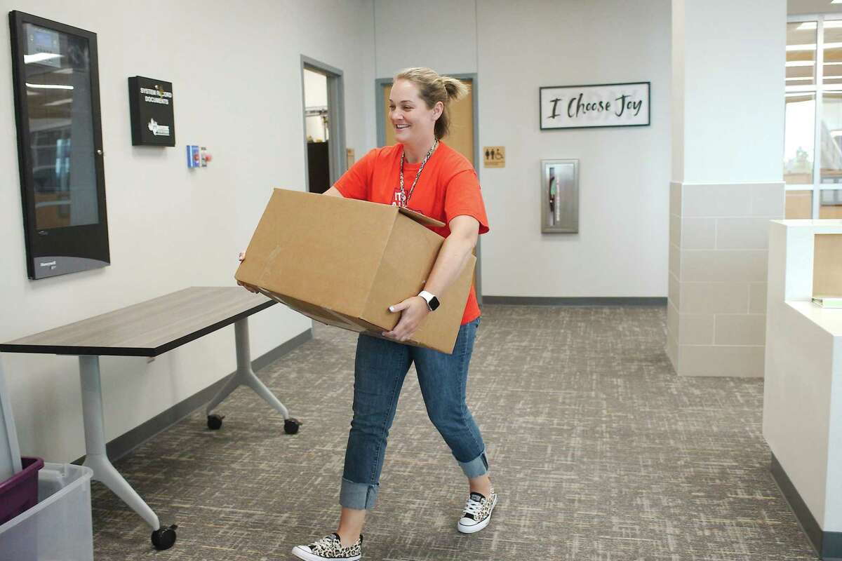 Caffey Principal Tina McCorkle is spending much of her time moving boxes as the school prepares to open.