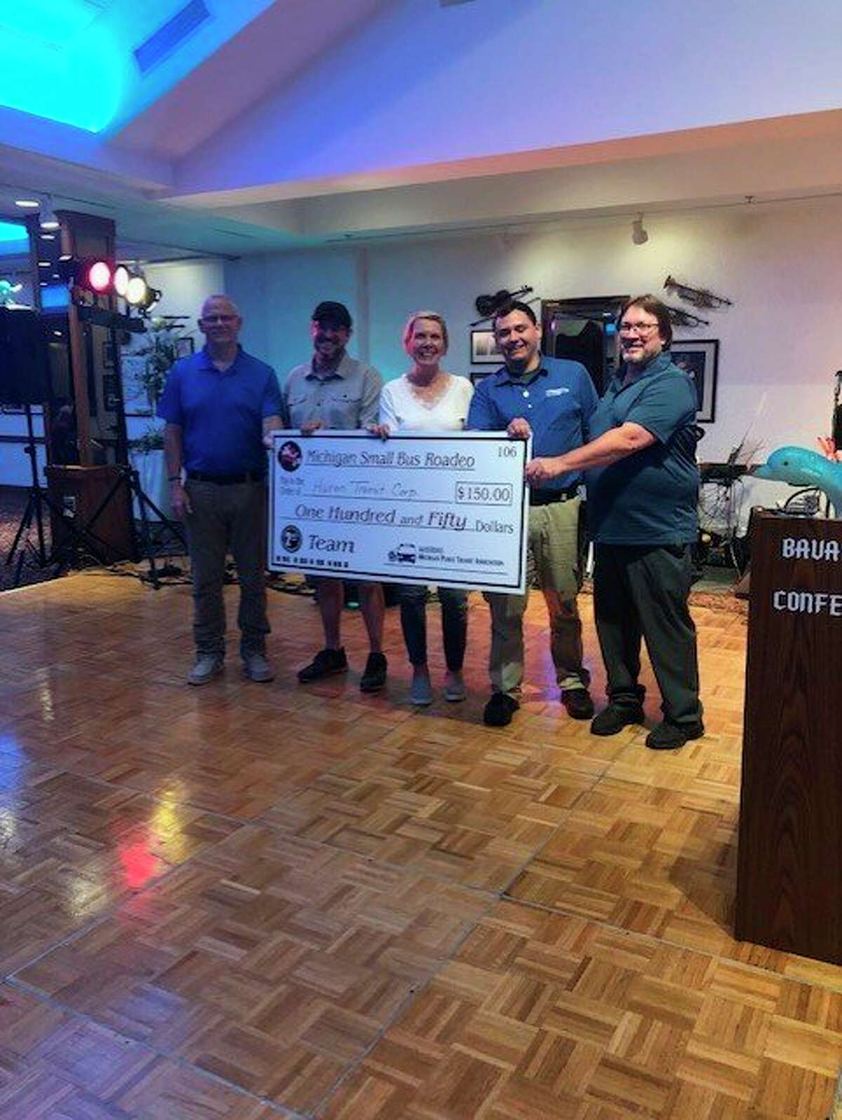 The Thumb Area Transit drivers that participated in this year's Small Bus Roadeoare presented with their prize money. (Thumb Area Transit/Courtesy Photo)
